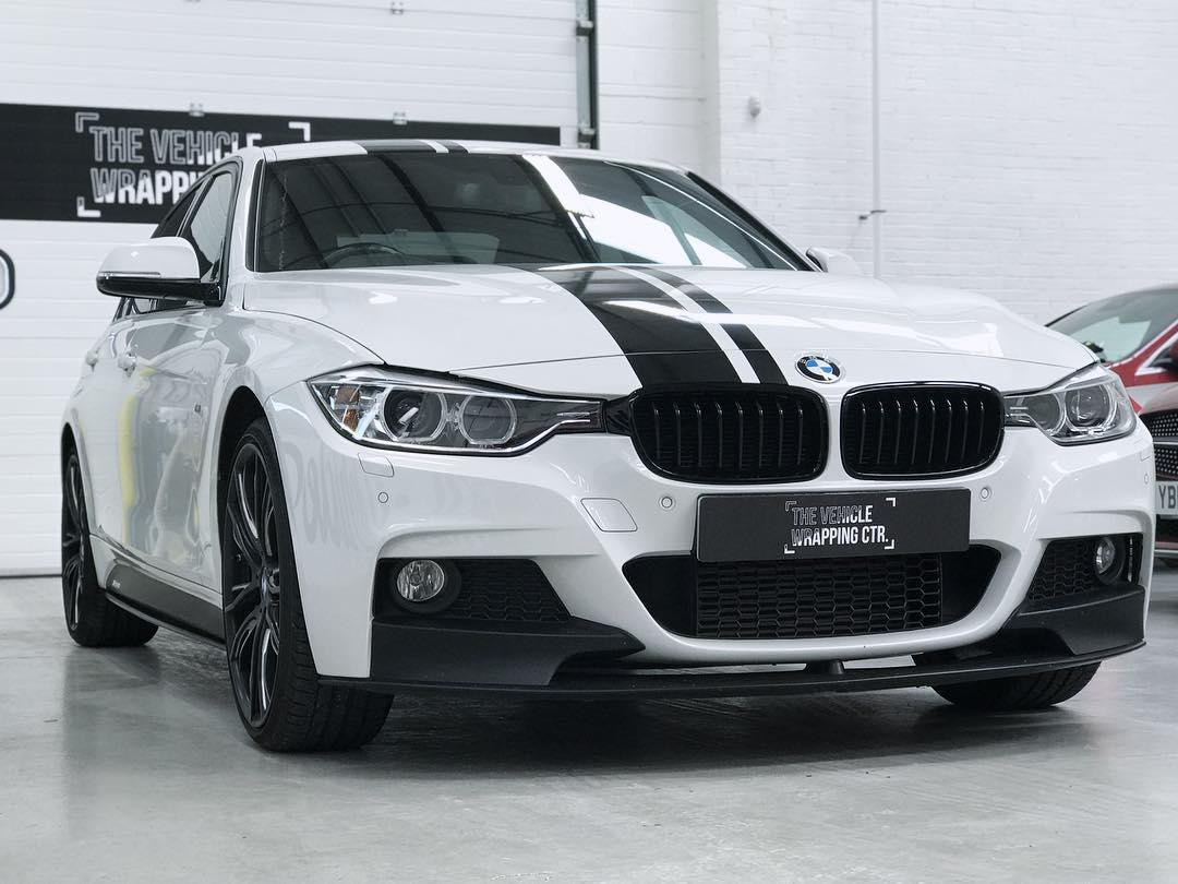 A beautiful BMW with a racing stripe, having undergone a new wrap at The Vehicle Wrapping Centre.