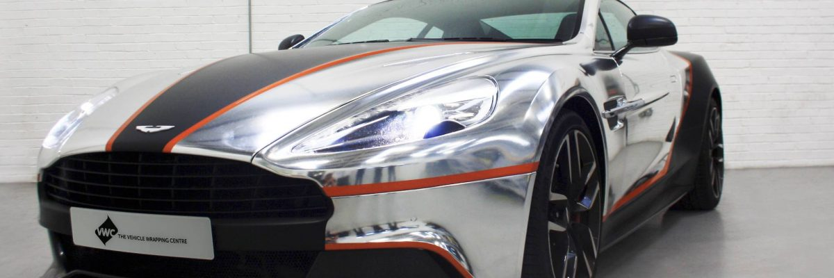 Aston Martin wrapped in black and silver and outlined with orange