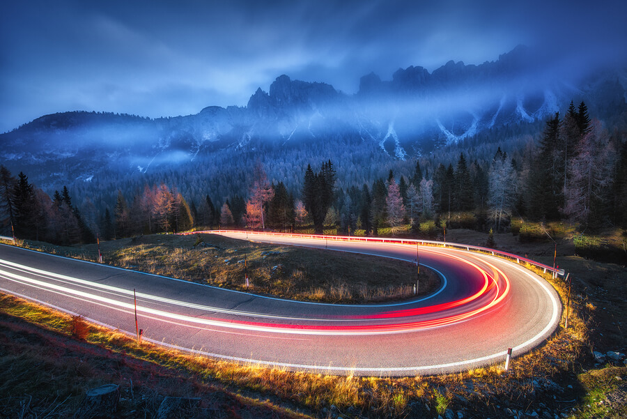 Long exposure of car driving around a bend in Europe.