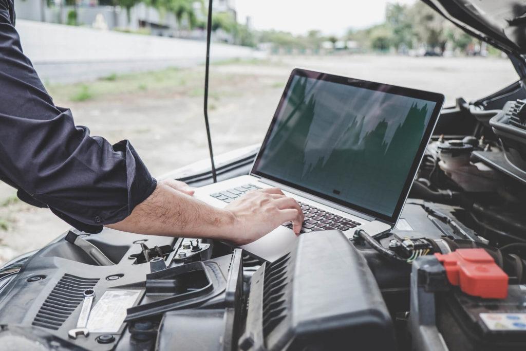 A car engine undergoing a digital diagnostics test.