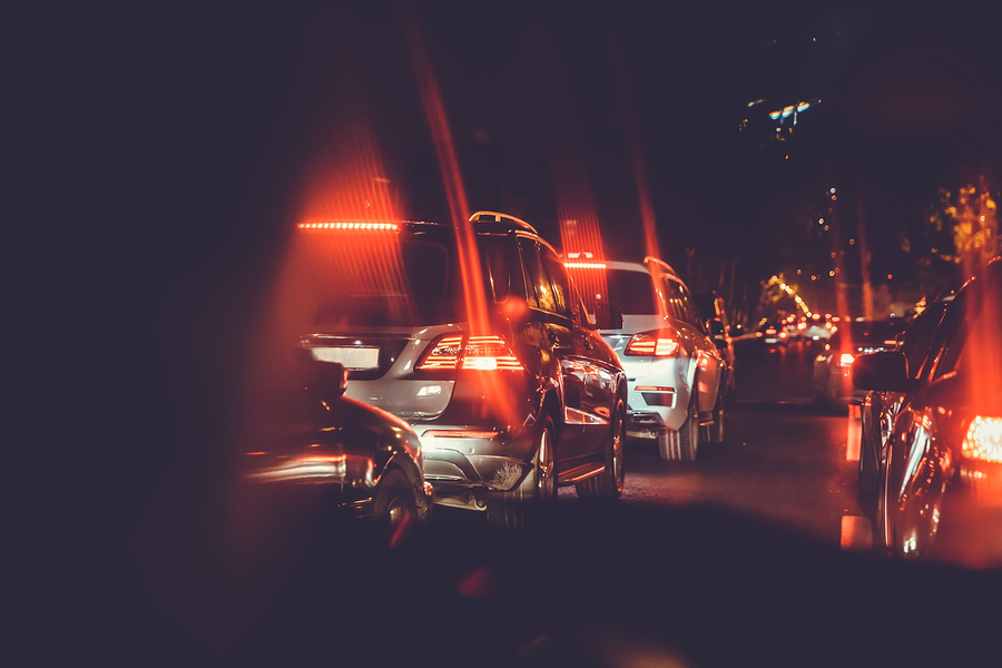 Cars are red, yellow night light. Looking behind the cars.Cars are red, yellow night light. Traffic jams in the city with row of cars on the road at night and bokeh lights in Baku with selective focus