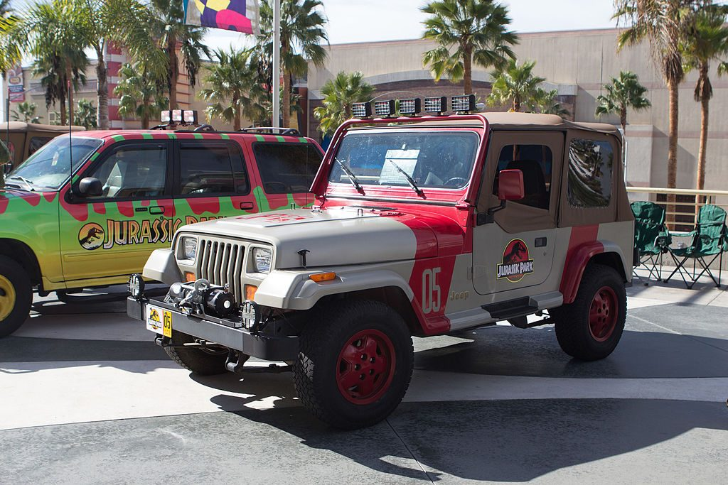 A picture of a Jurassic Park Jeep in a car park.