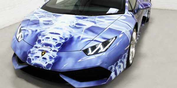 Lamborghini from the front showing the blue and white plasma style car wrap