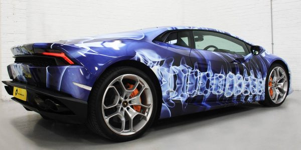 Lamborghini wrapped in a blue and white plasma themed car wrap