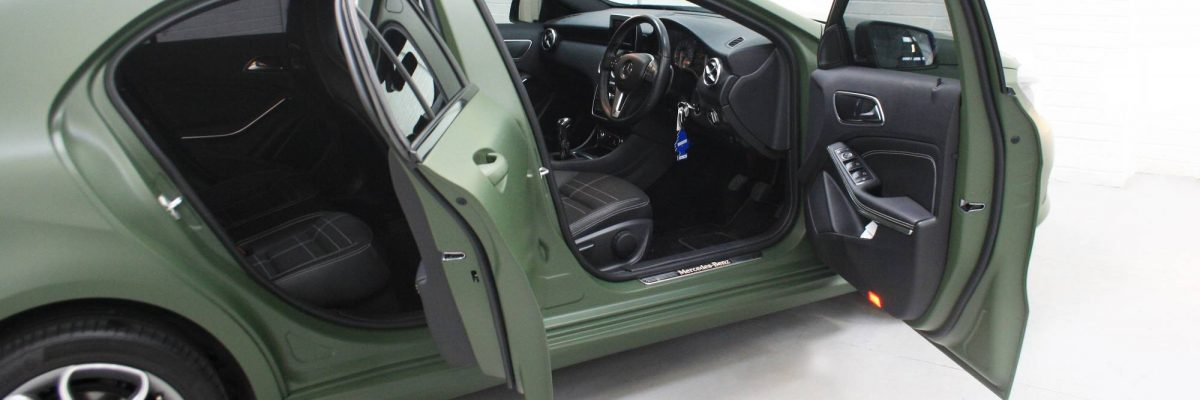 Mercedes Benz wrapped in an army green car wrap