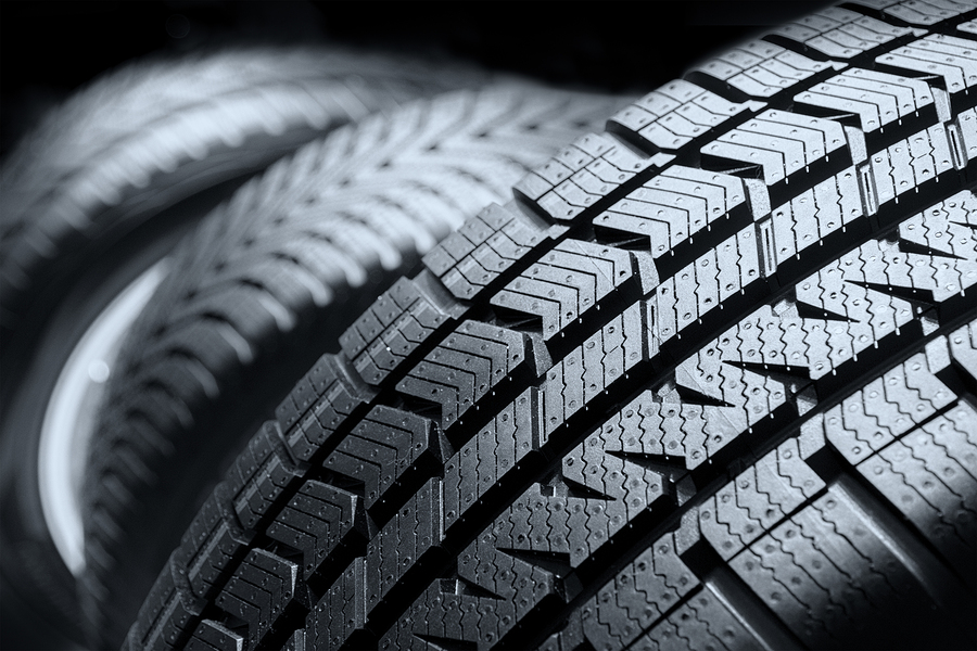 Close up black tyre profile car tires row