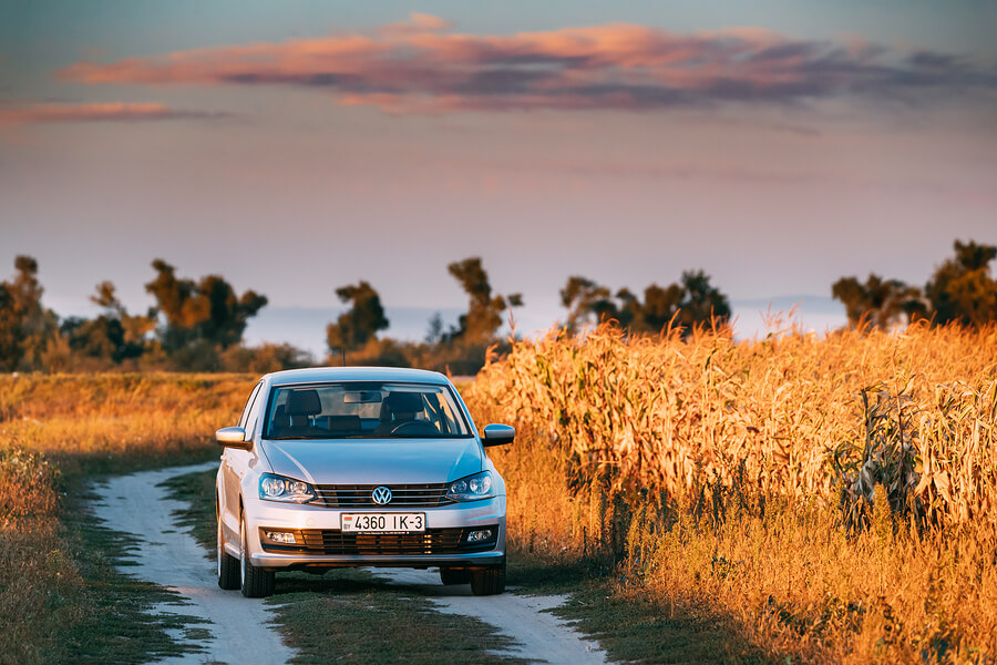 A Volkswagen Polo driving through the countryside.