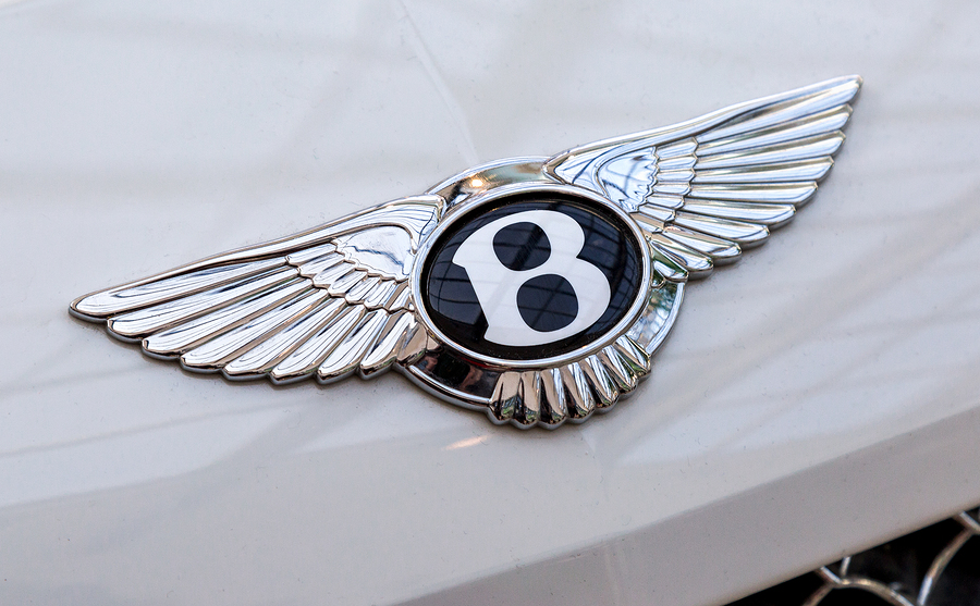"Bentley logo ""Flying B"" on the car. Bentley Motors Limited is a British manufacturer of luxury automobiles"
