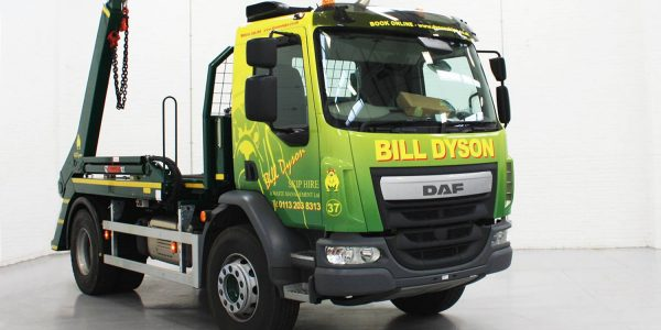 Green and yellow vinyl wrap on a bill dyson skip truck