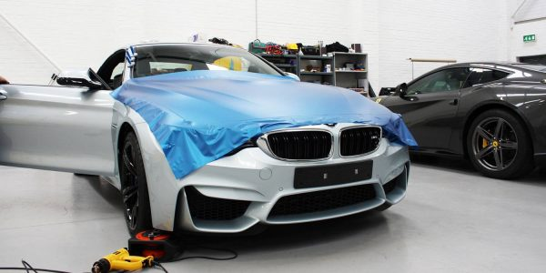 BMW in the process of being changed colour from white to blue