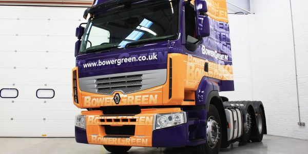 Purple and orange truck branded with a vinyl wrap
