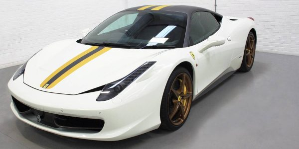White Ferrari detailed with black and yellow 3M vinyl