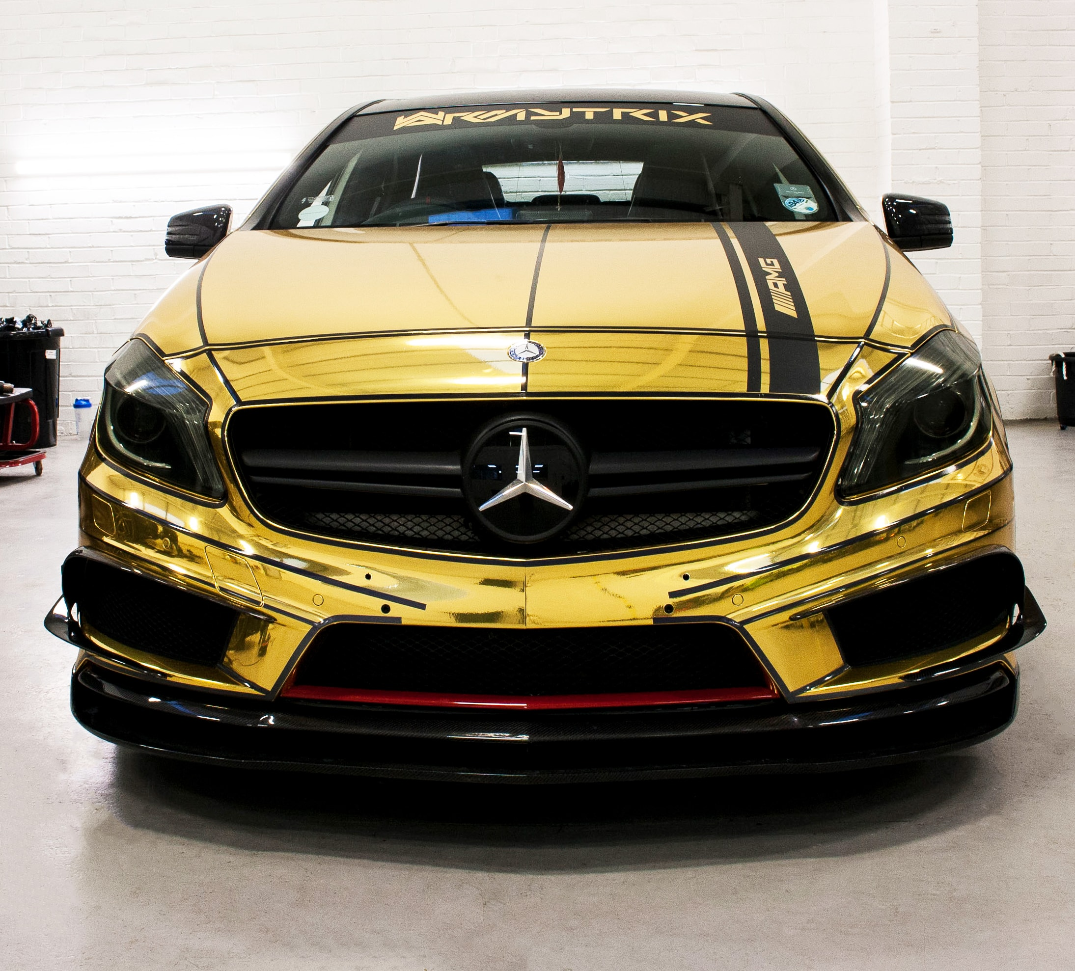 Golden vehicle wrap for Mercedes sports car