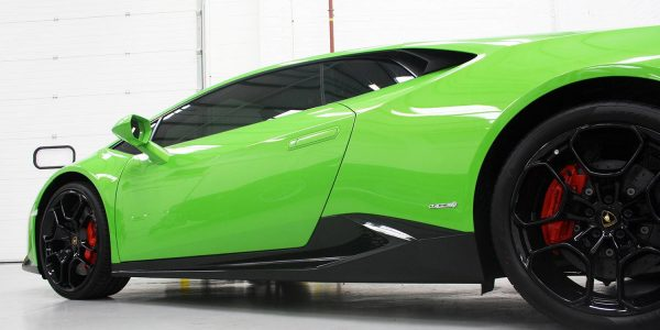 Sideshot of a green Lamborghini in vinyl wrap
