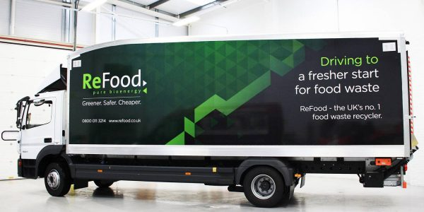 Green fading to black on side of large ReFood branded truck