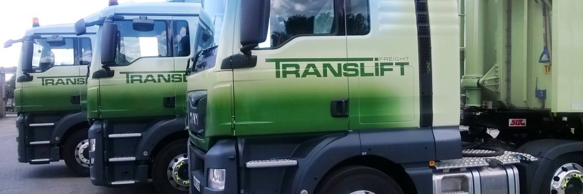 Three Translift trucks lined up in green and white 3M vinyl wrap