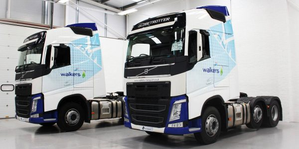 Two Walkers trucks wrapped in blue and white 3M vinyl